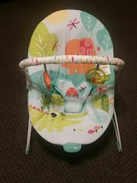 baby's white, green, and teal rocker bouncer