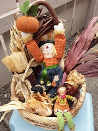 Basket of corn and 2 scarecrows   Vancouver, 98683
