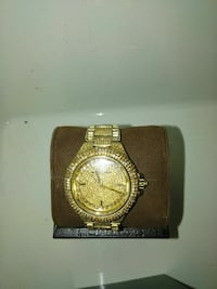 round gold Michael Kors analog watch with link bra