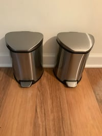 Pair of stainless steel trash cans.