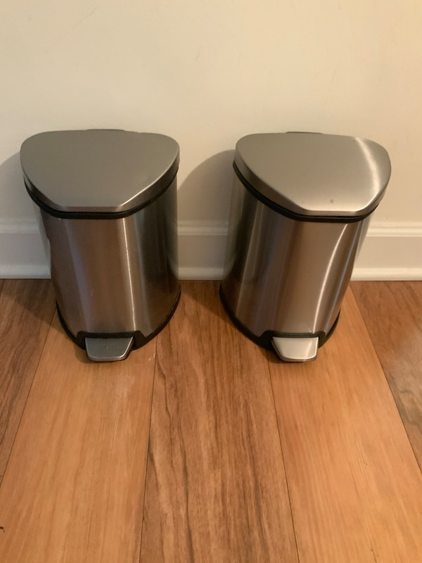 Pair of stainless steel trash cans. 2982438f-93ae-4de8-8e35-d369b6425fef