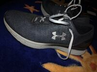 New Under armour black and white shoes RETAIL: $80  Palmhurst, 78599