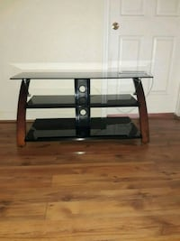 brown wooden frame glass top TV stand Houston