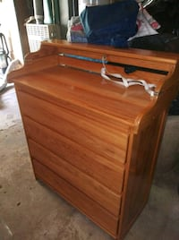 Dresser with convertible changing table on top