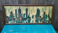 city buildings and sailboats painting with brown wooden frame