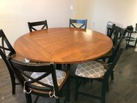 Dining table. Counter height.  When square seats 4, when round it seats 6. Includes buffet Woodbridge, 22192