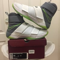 pair of white-and-green Nike sneakers Regina, S4S 3R1