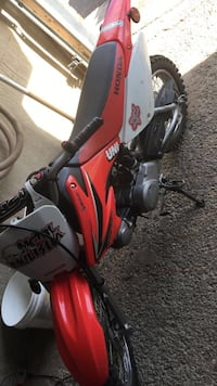 red and white Honda motocross dirt bike