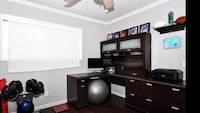 black wooden TV hutch with flat screen television Hesperia, 92344