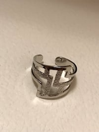 Size 5 ring brand new adjustable  Vancouver, V5R 2P9