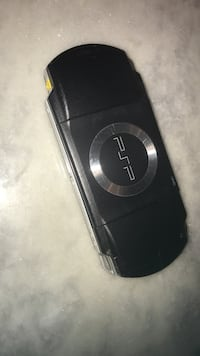Black sony psp with case and 1 game