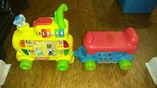 red and yellow learning plastic truck toy