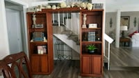 brown wooden TV hutch with flat screen television Las Vegas, 89109