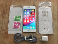 white Samsung Galaxy Android smartphone with charger and case 222 mi