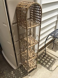 Decorative metal stand with 4 shelves and dome top