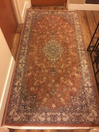 brown and white floral area rug Burnaby, V3N 3G4