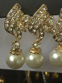 pair of gold-colored earrings East Brunswick