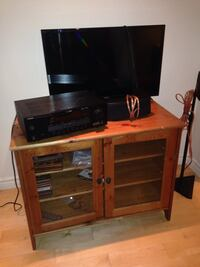 brown wooden TV hutch with flat screen television Montréal, H2T