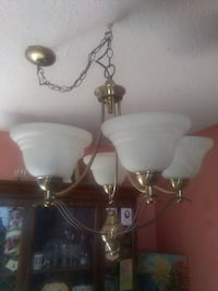 brass and white uplight chandelier