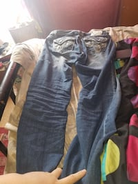 two pairs of blue and gray jeans Coal Hill, 72832
