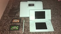 white Nintendo DS with game cartridges Edmonton, T5Y 0L6