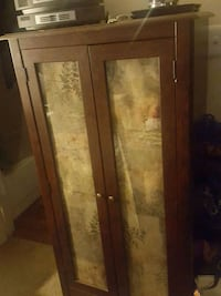 Brown glass door cabinet 20 km