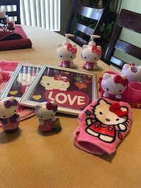 Hello Kitty bathroom items. 11 pieces; 2 rugs, toothbrush holders with cups, shower curtain, hand towel, body wash mitt, little figurine, 2 soap dispensers, and 2 picture frames   Pomona, 91766