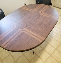 Wood Laminate Pedestal Table with 4 Cushion Metal Chairs
