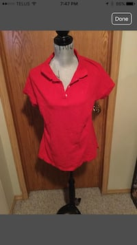 Women's red polo shirt. Calgary, T3G
