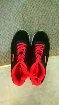 pair of black-and-red Nike running shoes Calgary, T1Y 2E4