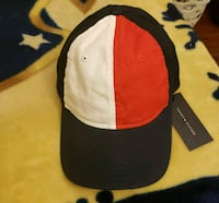 black, white, and red Tommy Hilfiger baseball cap