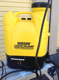 yellow and black Karcher pressure washer