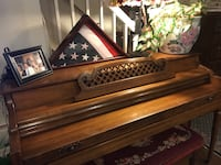 brown wooden upright piano with chair Alexandria
