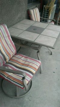 Patio Table + 4 swivel chairs with pads