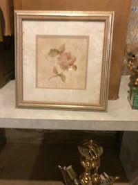 two brown wooden framed painting of flowers 45 mi