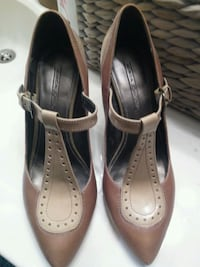 pair of brown leather heeled shoes