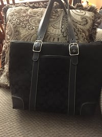 black monogrammed Coach leather tote bag