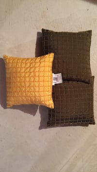 two brown and one yellow throw pillows