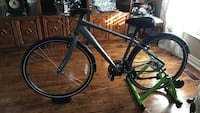 Black and grey road bicycle with green paddock stand Vaughan, L4L 5H7