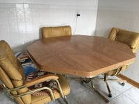 Wood Kitchen Table and four swivel chairs