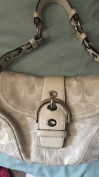 Cream coach purse used once has papers