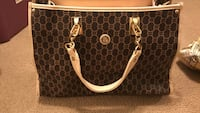 brown and white leather handbag