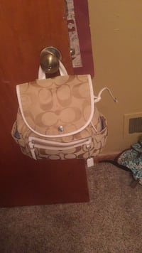 white and brown Coach leather handbag Huber Heights, 45424