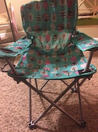 green and blue floral padded chair