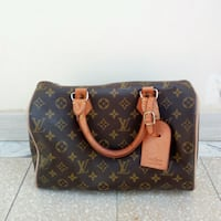 Tote bag in pelle Louis Vuitton nera e marrone Benevento, 82100