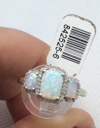 14kt white gold fashion ring with 0.25 carat of 40 round diamonds and 3 beautiful opals. Size 9.5 . 3.3 gr . 842525-6.  Baltimore, 21205