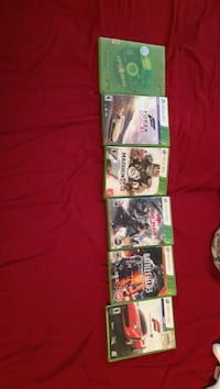three Xbox 360 game cases