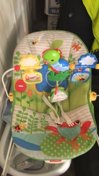 baby's green and white bouncer Lakewood, 80228