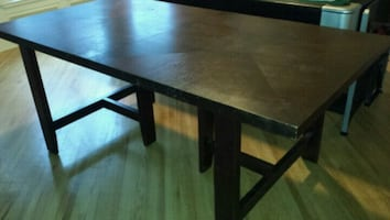 Strong sturdy table that can be used for dining or utility.