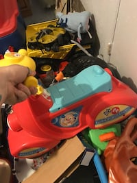 Blue, orange, and yellow fisher-price ride-on toy Auburndale, 33823
